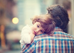 Little girl hugging father
