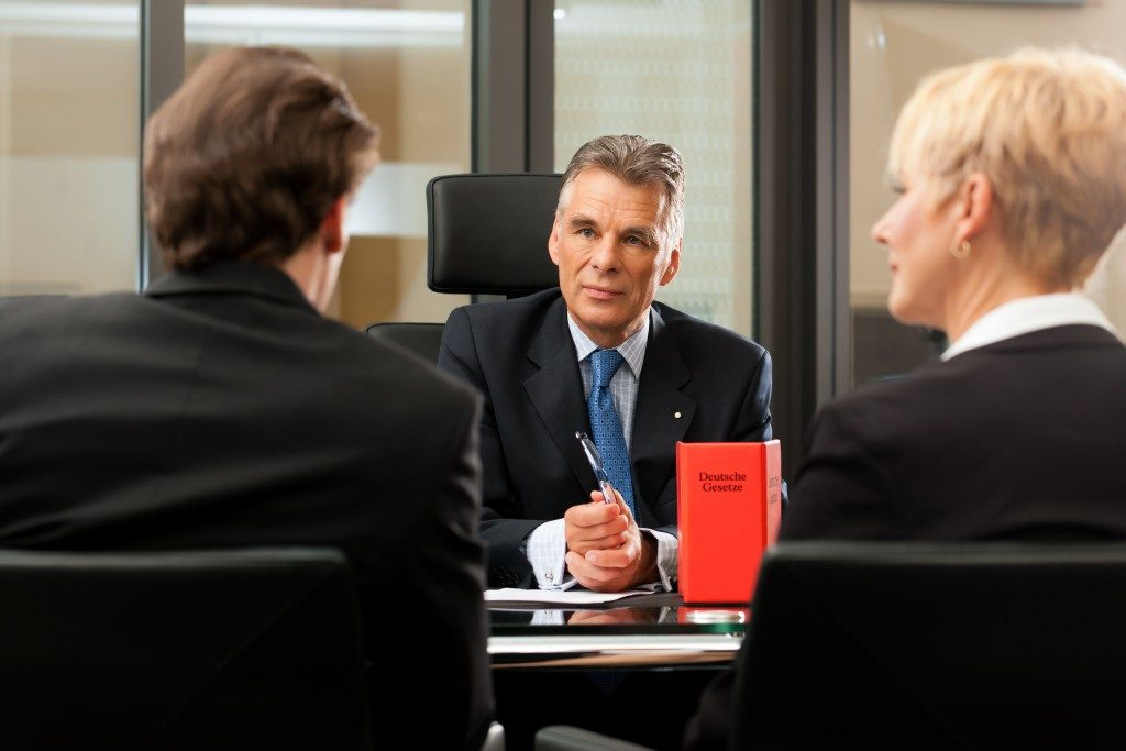 a man and a woman consulting a lawyer