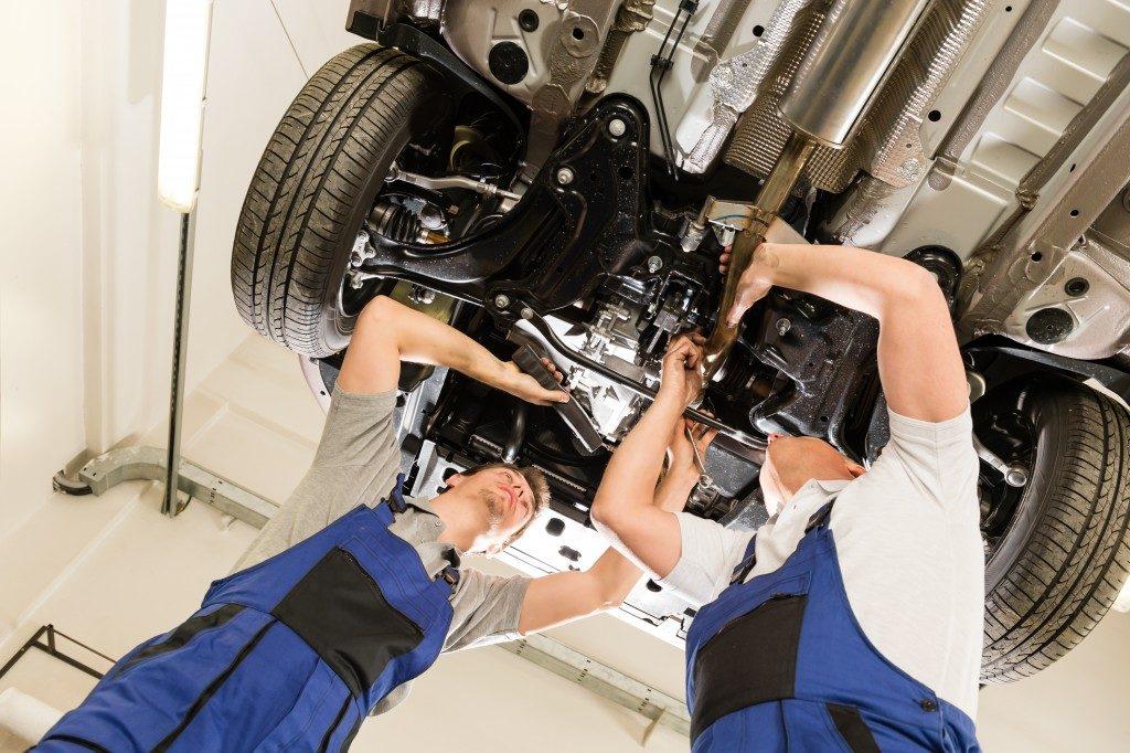 Auto mechanics working