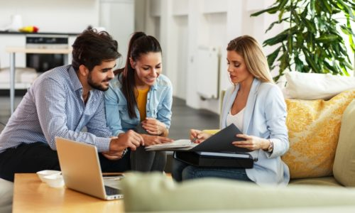 Couple talking to advisor about life insurance