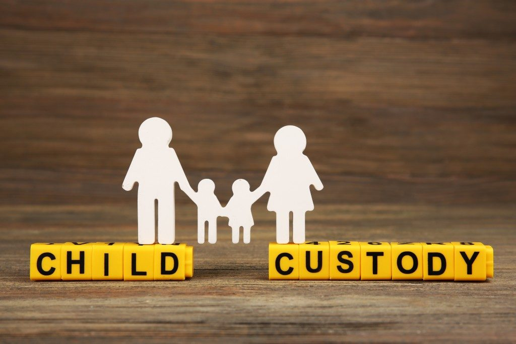 Child Custody Text with Family Paper Cut Out