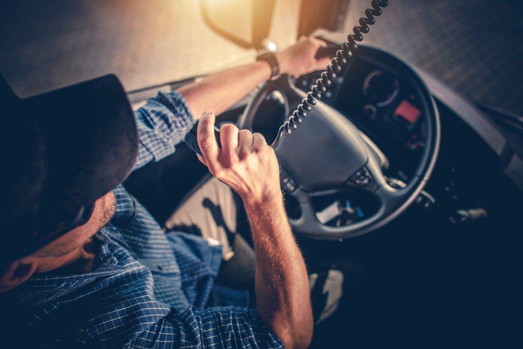 truck driver on radio communication device