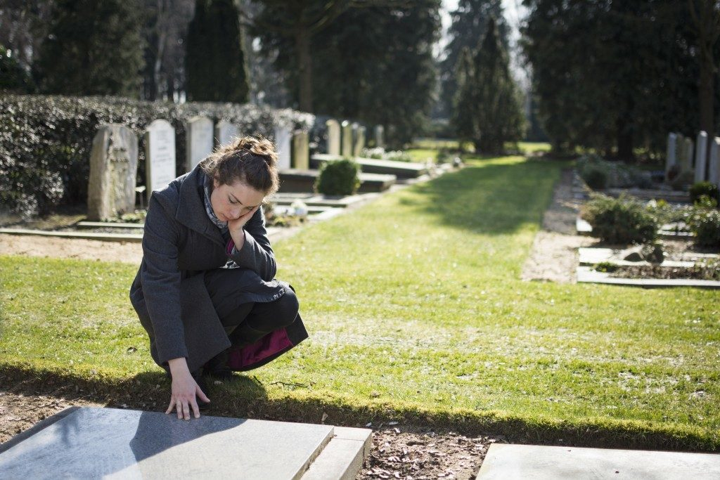 Woman visiting a grave