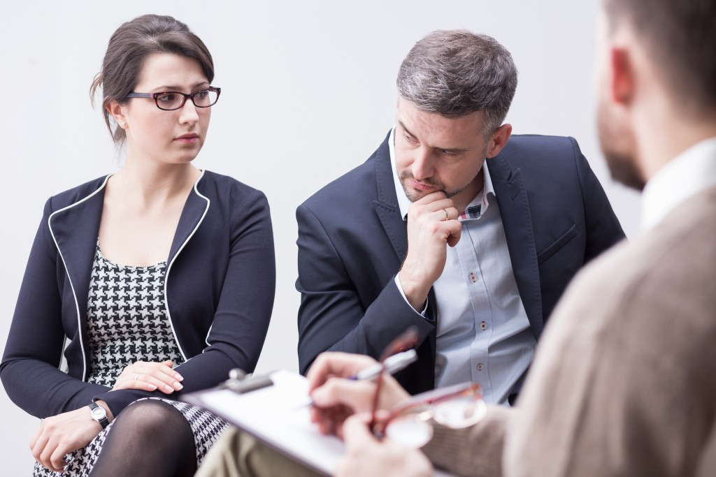 Couple talking to a consultant