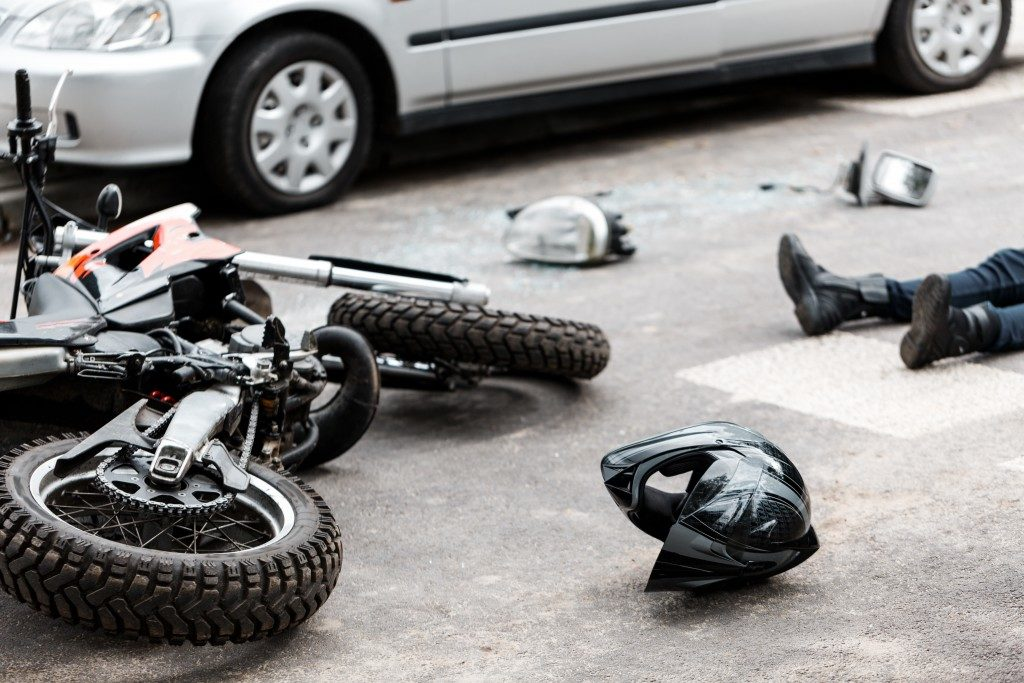 Motorcycle rider that met an accident with a car