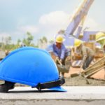 blue hard hat at a construction site